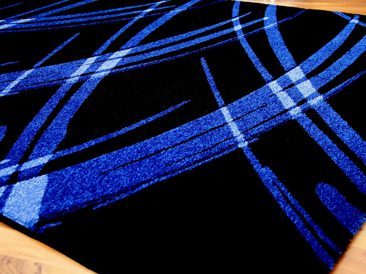 designer teppich maui schwarz blau life in 5 gr en teppiche designerteppiche maui teppiche. Black Bedroom Furniture Sets. Home Design Ideas